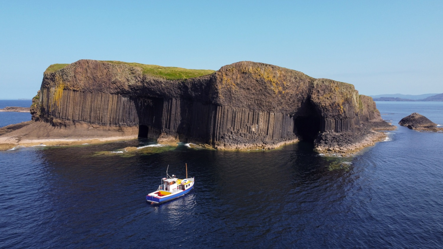 Island Lass boat approaching Fingals Cave on Staffa